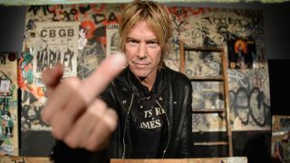 Guns N' Roses Duff McKagan giving the camera the finger