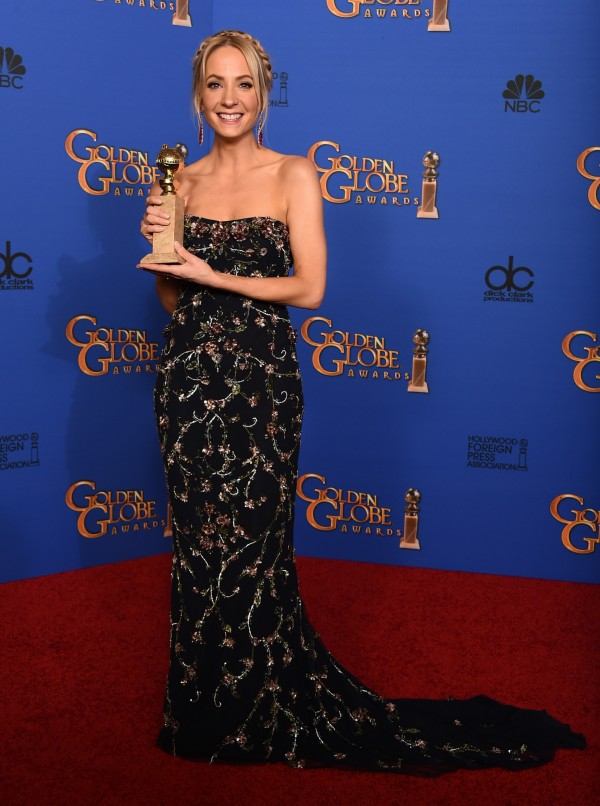 "Joanne Froggatt poses in the press room with the award for best supporting actress in a series, miniseries or television movie for ""Downton Abbe"