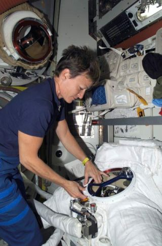 NASA: Spacesuit's Smoky Smell Prompts Spacewalk Ban