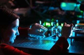 A scientist is working with equipment.