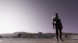 A pilot stands against a purple alien sky