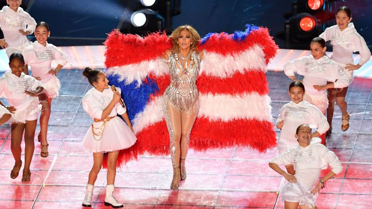 US singer Jennifer Lopez and her daughter Emme Muniz (L) perform during the halftime show of Super Bowl LIV between the Kansas City Chiefs and the San Francisco 49ers at Hard Rock Stadium in Miami Gardens, Florida, on February 2, 2020.
