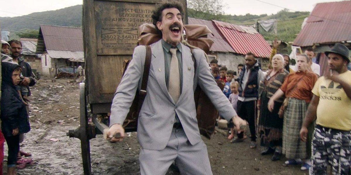 Borat Subsequent Moviefilm Borat pulls a cart through his village