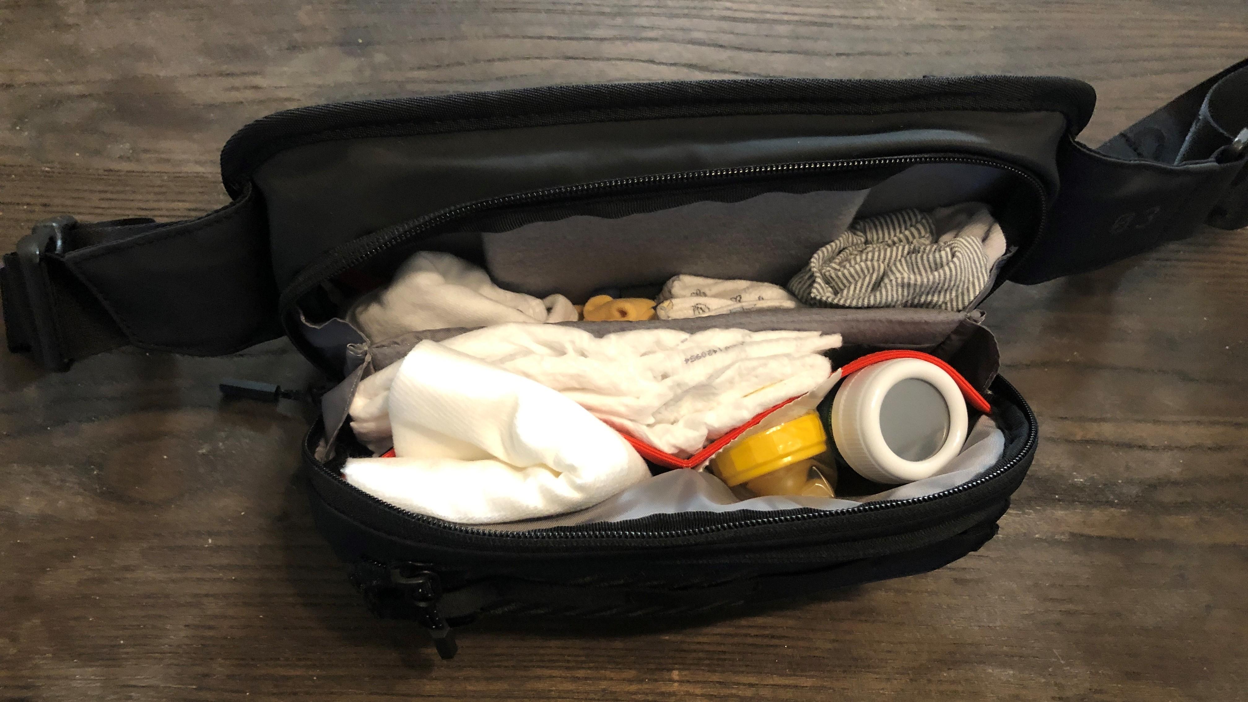 CS03 Cross body bag full of baby stuff.