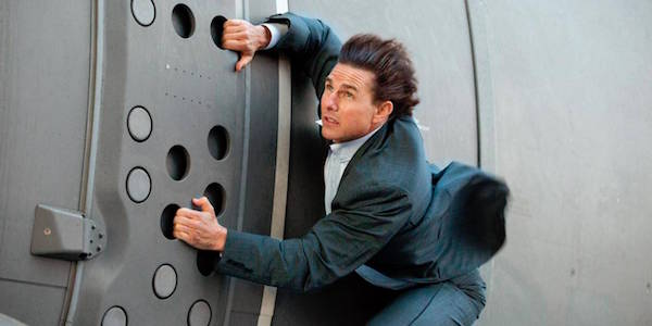 Tom Cruise hanging onto plane in Mission Impossible Rogue Nation