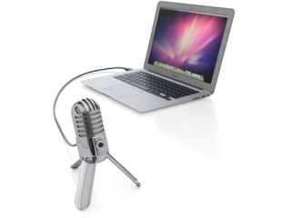 A Samson Meteor mic tries to run away from a MacBook Air.