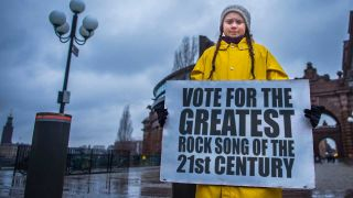 Greta Thunberg with voting placard