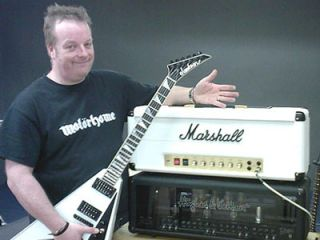 Guitarist's Simon Bradley with the only guitar that's up to the job...
