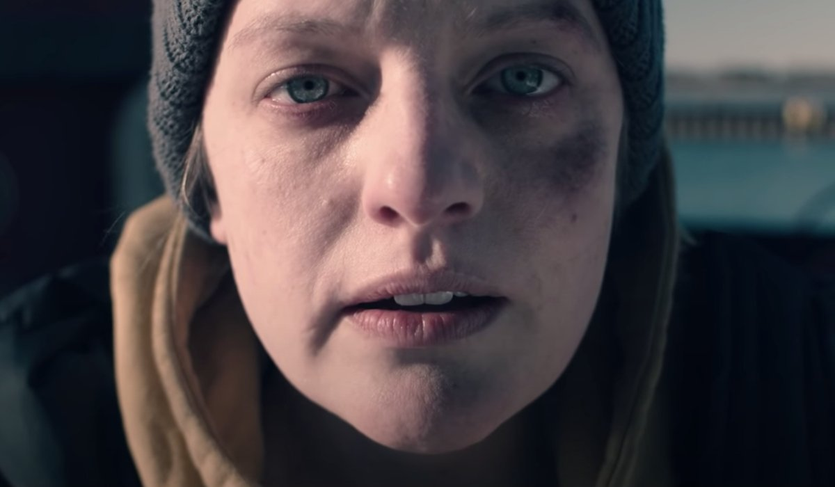 Elisabeth Moss looks bruised and dazed in The Handmaid's Tale.