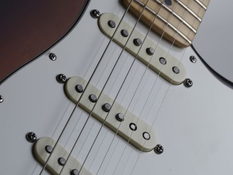 The 2012 American Standard Strat has Custom Shop Fat '50s pickups with staggered poles.