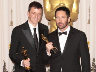 Atticus Ross (left) and Trent Reznor celebrate Oscar glory.