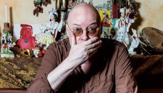 Andy Partridge at home with his hand over his mouth
