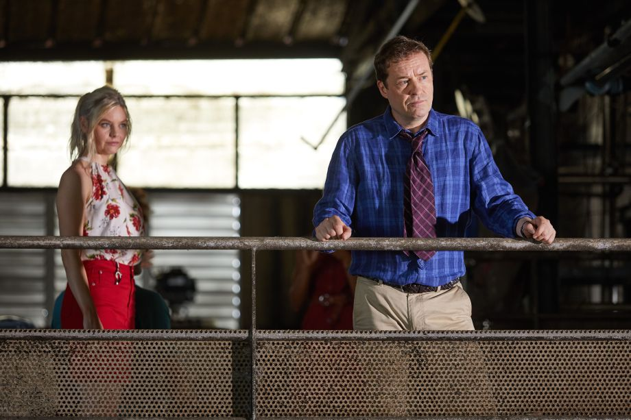 Death in Paradise star Ardal O'Hanlon as DI Jack looking thoughfully into the distance