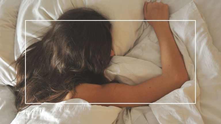 High Angle View Of Young Woman Sleeping On Bed At Home - stock photo