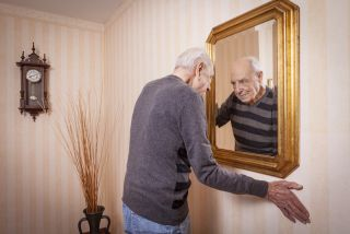 man looking at mirror