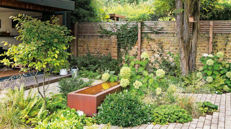 small garden water feature ideas: corten steel design with hydrangeas