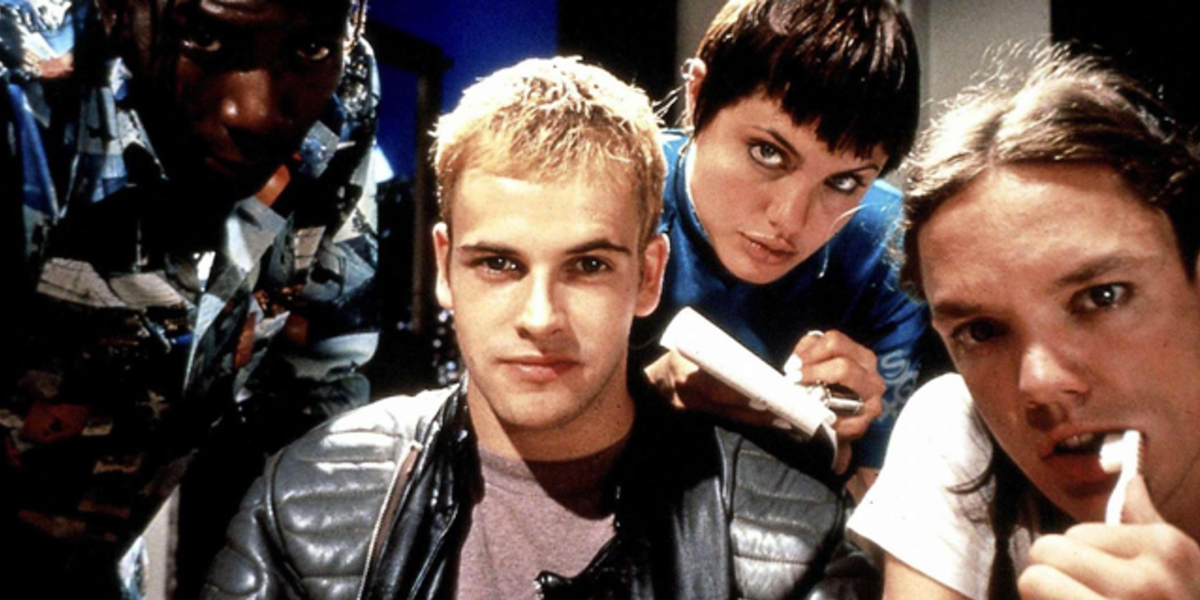 Laurence Mason, Jonny Lee Miller, Angelia Jolie and Matthew Lillard look into the camera in a promotional image for Hackers