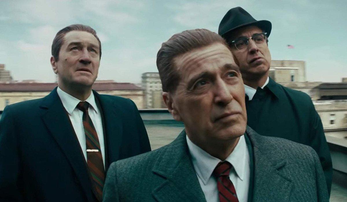 The Irishman Al Pacino Robert DeNiro and Ray Romano standing on the roof, looking in the same direct