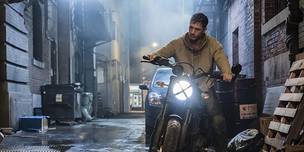 Venom Eddie Brock sits on his motorcycle in a steamy alley