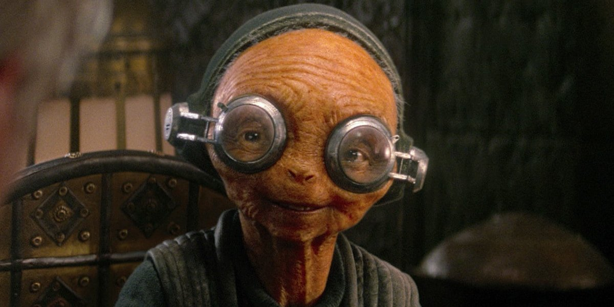 Star Wars: The Force Awakens Maz Canata smiling in her chair
