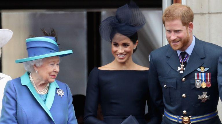 Prince Harry and Meghan Markle join the Queen to watch the RAF flypast on the balcony of Buckingham Palace