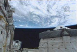 Astronauts Inspect Shuttle Heat Shield for Dings