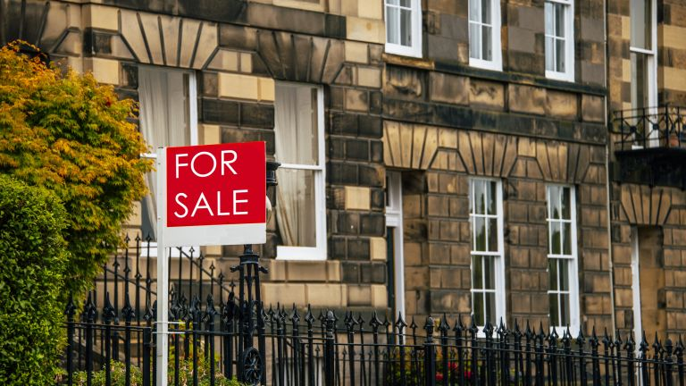How to buy a house: For sale sign outside a terraced town house