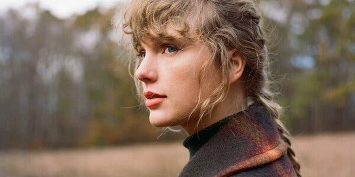 Taylor Swift posing for evermore album art