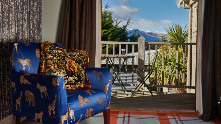 Dark blue chair overlooking mountains in New Zealand