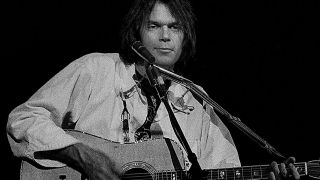 Neil Young performs in Atlanta on November 24, 1976