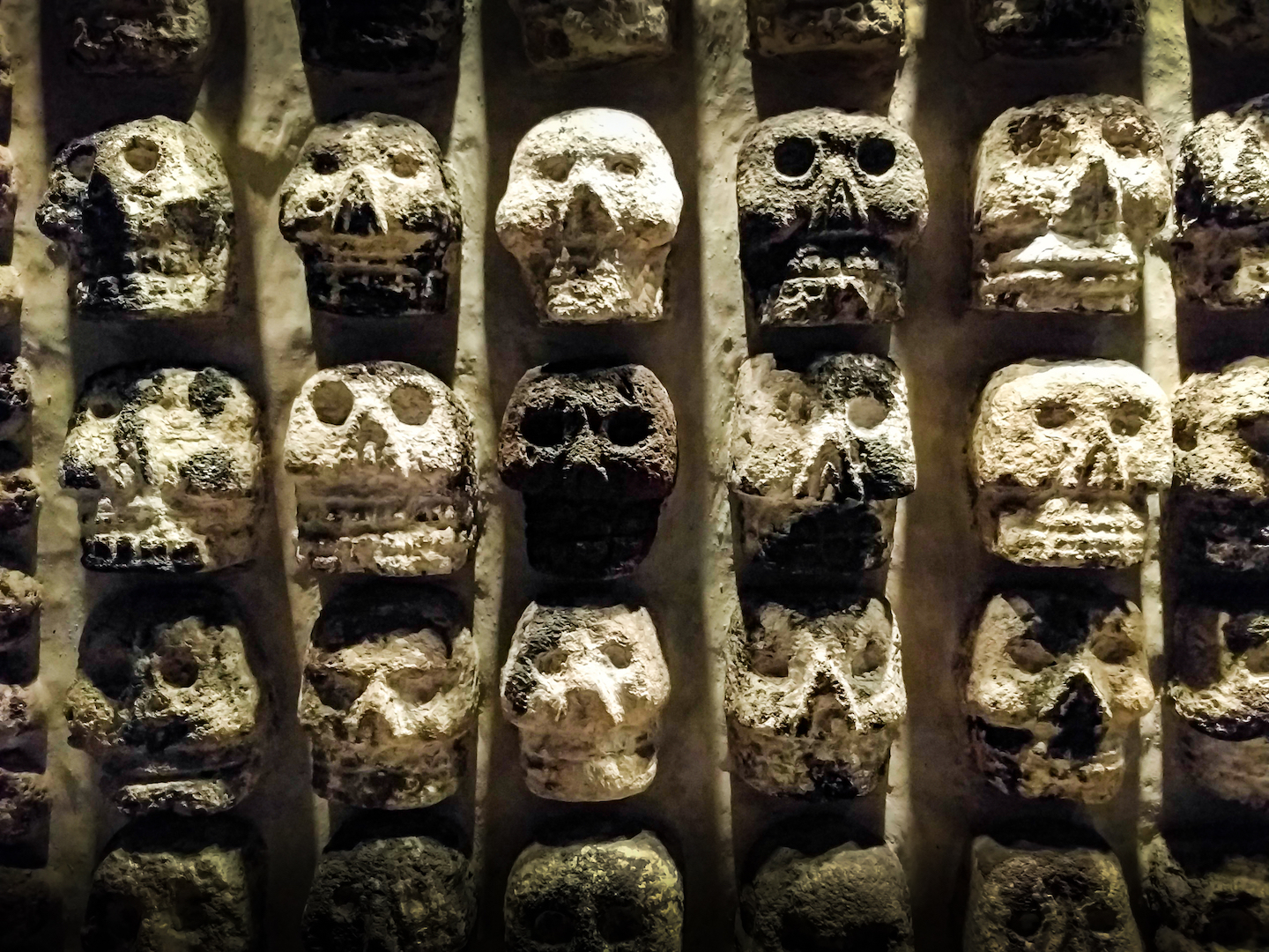 A stone wall with skull carvings found at the Templo Mayor in Zocalo, Mexico City.
