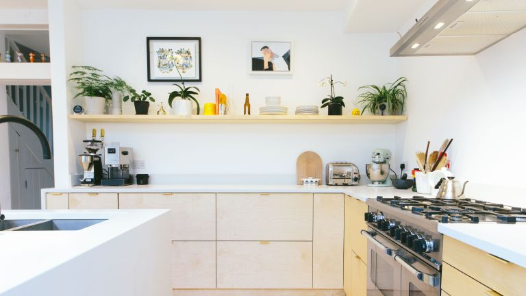 kitchen with white scheme and plywood finish cabinets by plykea