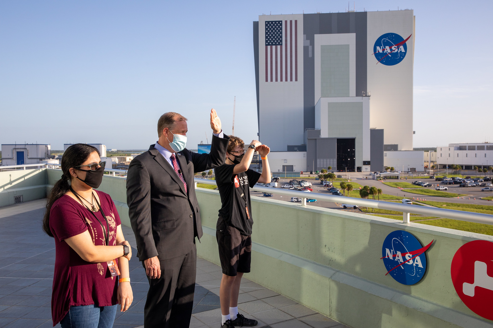 Vaneeza Rupani, who proposed the name Ingenuity, NASA Administrator Jim Bridenstine, and Alex Mather, who proposed the name Perseverance, watch from Kennedy Space Center as the Mars 2020 mission blasted off from Florida.