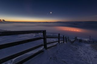 Venus and Jupiter hang over a frozen United Kingdom during a previous apparent conjunction of planets.