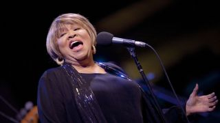 Mavis Staples singing onstage
