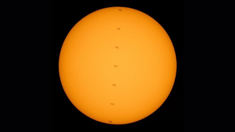 Wow! NASA photographer spots space station crossing the sun during spacewalk