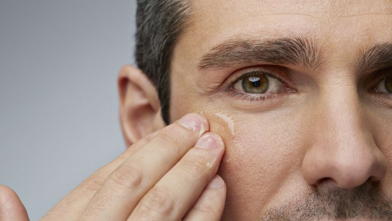 A man rubbing eye cream under his eye. The best men's eye cream