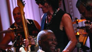 Jeff Beck and BB King smiling onstage at a concert.