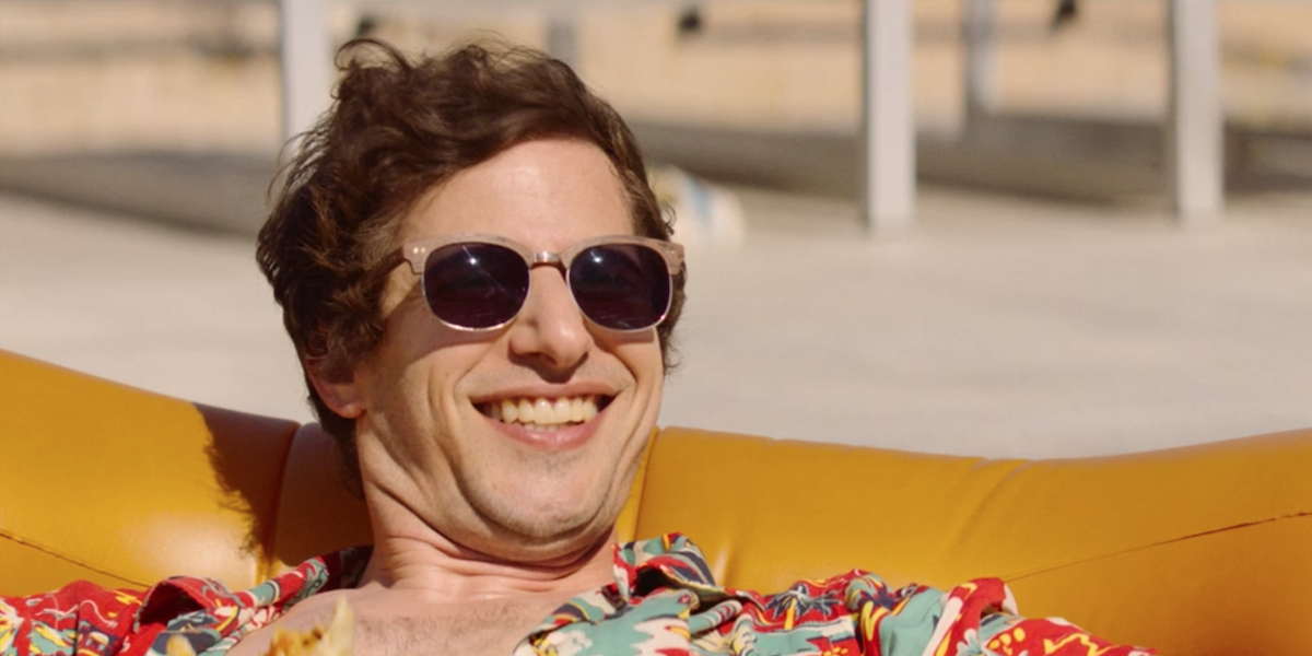 Andy Samberg smiling in Palm Springs