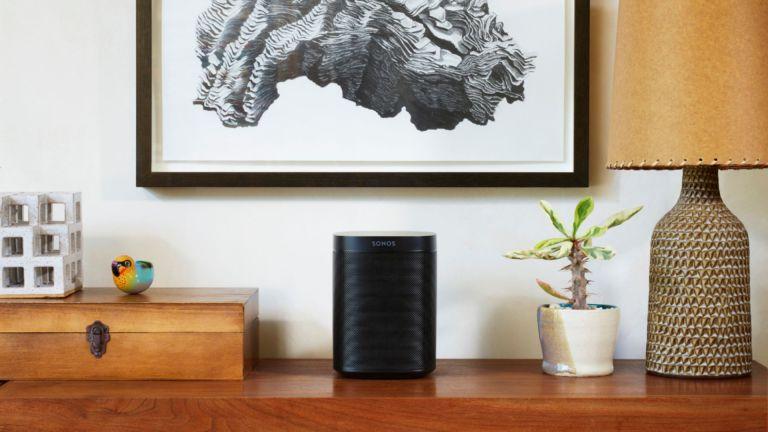 best Alexa speaker: Sonos One on side table under gray painting
