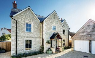 Timber frame Cotswold stone home in Wiltshire