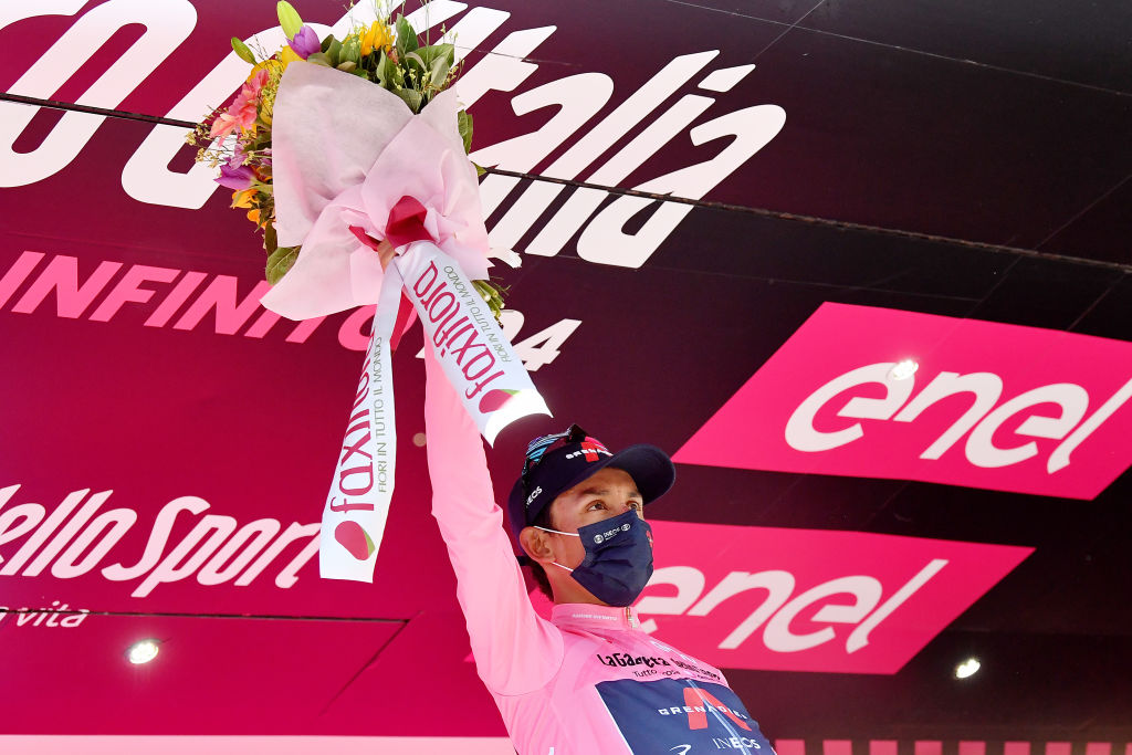 FOLIGNO ITALY MAY 17 Egan Arley Bernal Gomez of Colombia and Team INEOS Grenadiers Pink Leader Jersey celebrates at podium during the 104th Giro dItalia 2021 Stage 10 a 139km stage from LAquila to Foligno Miss Hostess Mask Covid safety measures Trophy Flowers Mascot girodiitalia Giro on May 17 2021 in Foligno Italy Photo by Stuart FranklinGetty Images