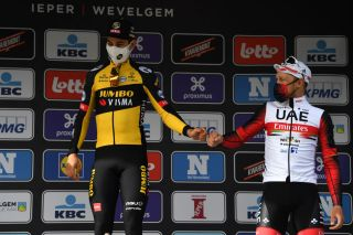 WEVELGEM BELGIUM MARCH 28 Podium Wout Van Aert of Belgium and Team Jumbo Visma Matteo Trentin of Italy and UAE Team Emirates Celebration during the 83rd GentWevelgem in Flanders Fields 2021 Mens Elite a 254km race from Ypres to Wevelgem Celebration Social distancing Mask Covid Safety Measures GWE21 GWEmen FlandersClassic on March 28 2021 in Wevelgem Belgium Photo by Tim de WaeleGetty Images