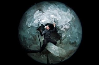 A researcher stands inside the crystal-filled cave known as the Pulpí Geode — the largest geode on Earth.