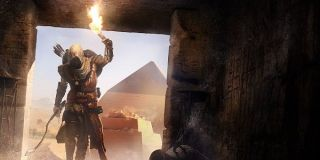 An assassin enters a pyramid in Assassin's Creed Origins.