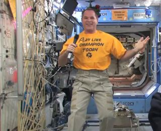 NASA astronaut Kevin Ford supports the University of Notre Dame for BCS Champsionship 2013.