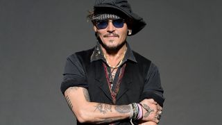 Johnny Depp Is Just Killing Time Until His Band Gets Back Together