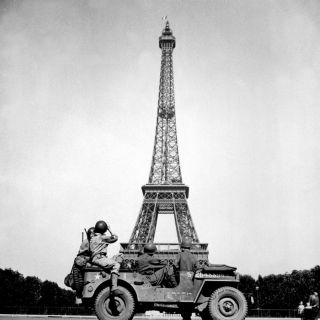 the 4th U.S. Infantry Division look at the Eiffel Tower