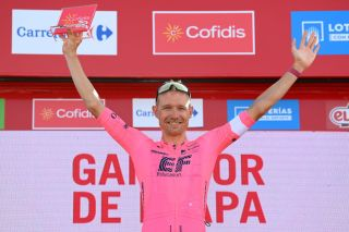 ALTO DE LA MONTAA DE CULLERA SPAIN AUGUST 19 Magnus Cort Nielsen of Denmark and Team EF Education Nippo celebrates at podium as stage winner during the 76th Tour of Spain 2021 Stage 6 a 1583km stage from Requena to Alto de la Montaa de Cullera 184m lavuelta LaVuelta21 on August 19 2021 in Alto de la Montaa de Cullera Spain Photo by Stuart FranklinGetty Images