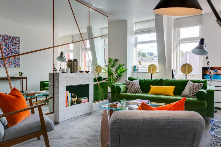 Small living with green sofa and modern furniture with mirror wall